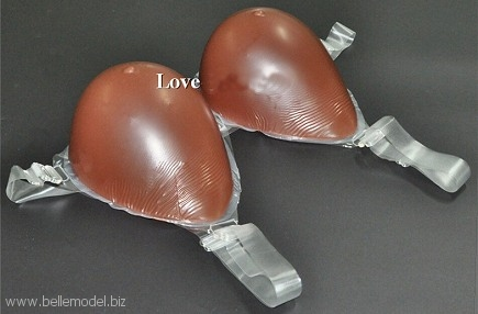 Silicone breast forms - With shoulder straps, teardrop , hollow back, brown. View angle. South Africa, Pretoria