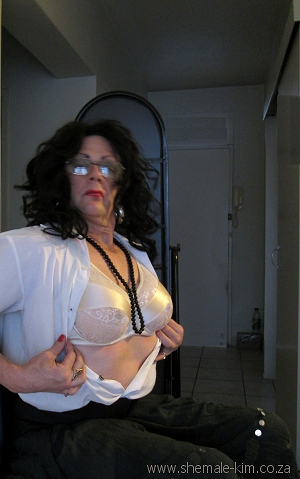 Crossdresser wearing silicone breast forms without shoulder straps inside a pocket bra. South Africa, Pretoria
